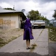 Laurinda, a young Kamilaroi girl, plays with her dress as she waits for the bus that will take her to Sunday school. (Raphaela Rosella, Portraits, 1st prize singles)